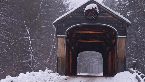 The Corbin Covered Bridge in Newport, NH, in a light snow storm. It's still wearing it's Christmas decoration.    For a map of New Hampshire's covered bridges please visit www.jcbwalsh.com/map/nh/covered-bridge.php .